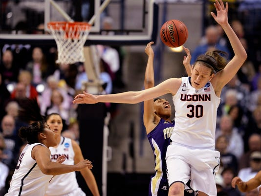Connecticut's Breanna Stewart, front right, Kaleena Mosqueda-Lewis, left, and Prairie View A&M's Larissa Scott, back center, vie for a loose ball during the first half of a first-round game of the NCAA women's college basketball tournament, Sunday, March 23, 2014, in Storrs, Conn. (AP Photo/Jessica Hill)