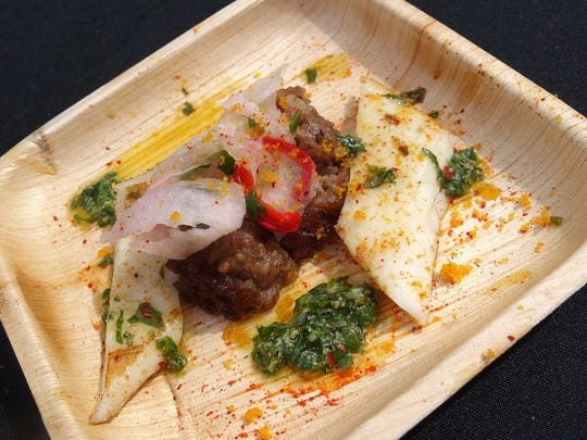 GOLD MEDAL: Humboldt squid and grilled cotechino with salsa verde, kohlrabi kimchi and dried mullet roe from Palo Verde at the Devour Culinary Classic