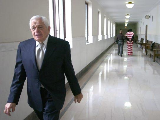 Stan Chesley walks the halls of the Hamilton County