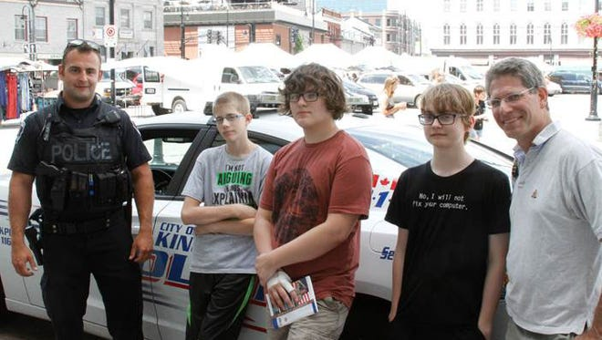 The constable is shown standing with scouts, from left, Andrew Wetzel, Justin Henninger and Kaleb Rigler and Scoutmaster Jeff Rosenzweig.