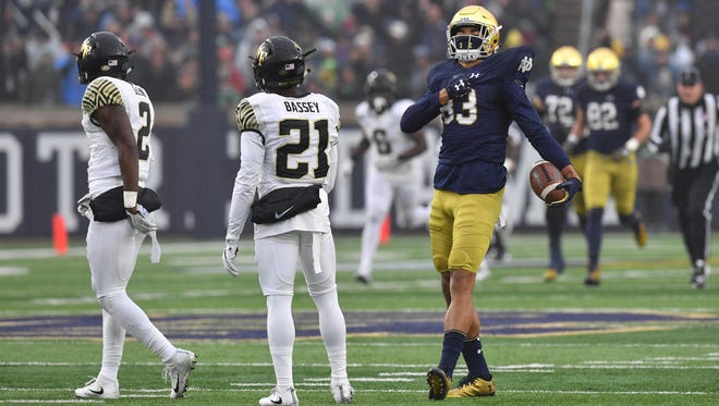 Nov 4, 2017; South Bend, IN, USA; Notre Dame Fighting Irish wide receiver Chase Claypool (83) celebrates in front of Wake Forest Demon Deacons safety Cameron Glenn (2) and cornerback Essang Bassey (21) after a catch in the second quarter at Notre Dame Stadium. Mandatory Credit: Matt Cashore-USA TODAY Sports