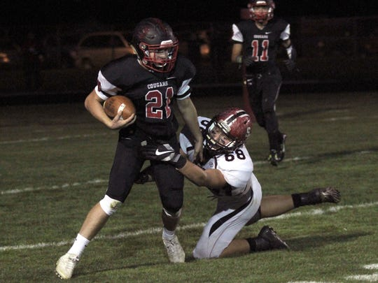 Crestview's Sage Baith is tackled by Norwalk St. Paul's Davis Hedrick during Friday night's Firelands Conference game.