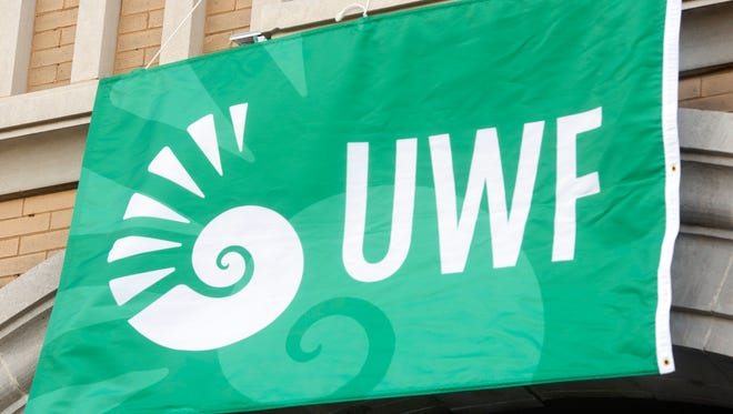 The University of West Florida unveiled its new flag design during the kick off to Founders Week during a ceremony in downtown Pensacola Monday, April 16, 2018.