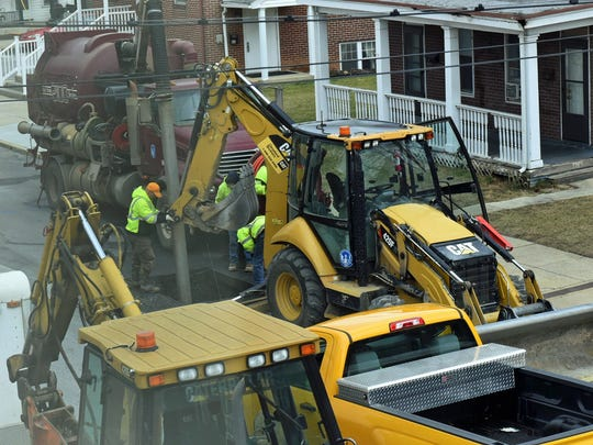 Borough of Chambersburg utility workers are repairing a minor broken water line near the intersection of North Third and King streets on Wednesday, February 1, 2017.
