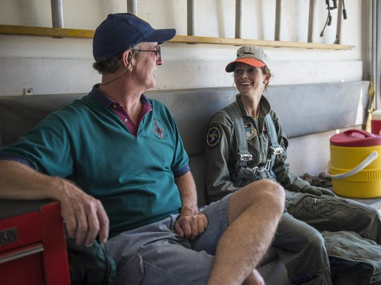 Retired Col. David and his daughter, Cadet 2nd Class Kaitlyn, ride back to the debriefing room after Kaitlyn's first flight in an Air Force jet July 12, 2016 at Holloman Air Force Base, N.M. David coordinated with Detachment 1 of the 96th Test Group to surprise his daughter with a bucket of water after she got out of the jet. Drenching pilots with water after milestones in their career is a tradition that began in Vietnam, and one that David had the opportunity to pass on to his daughter. (Last names are being withheld due to operational requirements. )