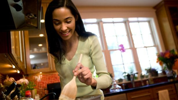 Woman cooking in suburban kitchen