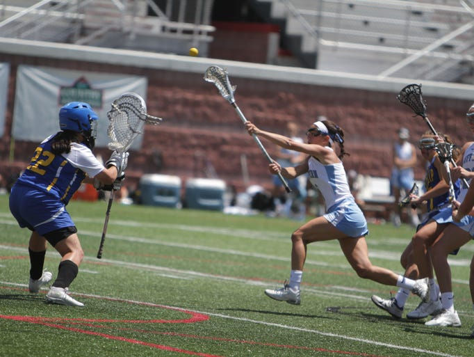 Suffern's Baley Parrott takes a shot on net against