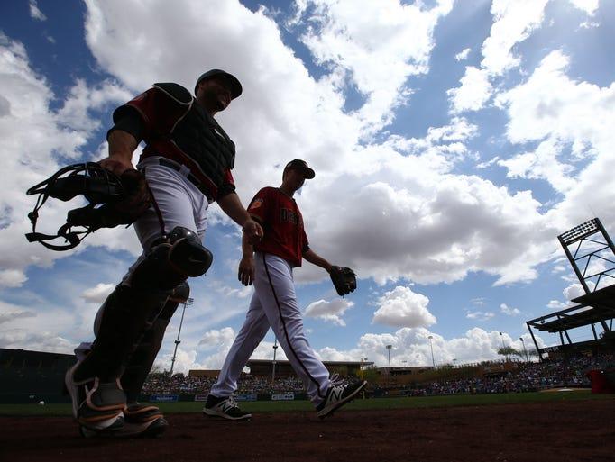 Arizona Diamondbacks pitcher Zack Greinke walks to