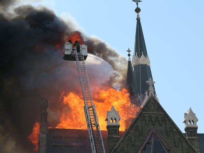 Firefighters battle a fire at Trinity Lutheran Church