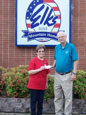 Don Swanson, Mountain Elks lodge 1714 president, donates $500 to Sandra Anderson, Ozark Center of Hope executive director, to help serve the needs of Baxter County residents living in poverty.