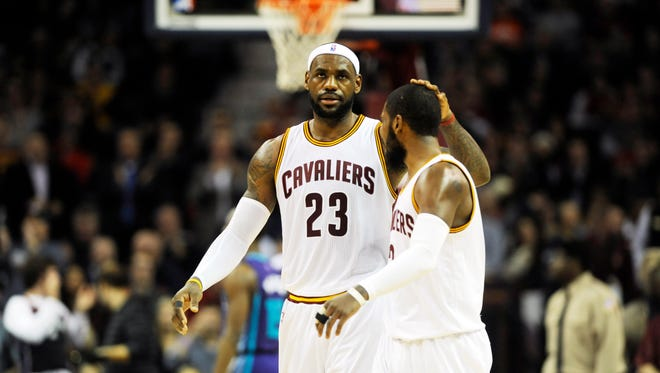 Cleveland Cavaliers forward LeBron James (23) celebrates with Cleveland Cavaliers guard Kyrie Irving (2) after a play during the second quarter against the Charlotte Hornets at Quicken Loans Arena.