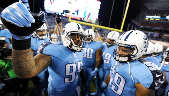 Titans defensive end Jurrell Casey (99) gets the team fired up before the game against the Jaguars at Nissan Stadium Thursday, Oct. 27, 2016.