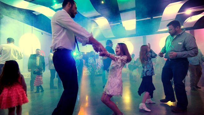 Jared Stevens (left) dances with his daughter Landry, 11, during the Daddy Daughter Date Night on Thursday, Feb. 9, 2017, at the Abilene Convention Center.