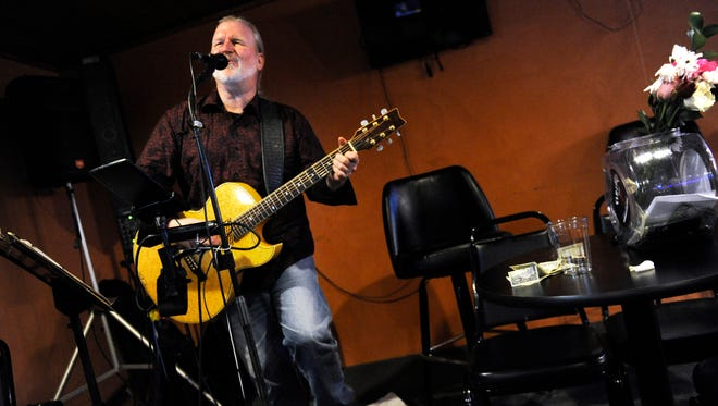 Tony Barker performs at the the Hour Glass Club Sunday Feb. 19, 2017.