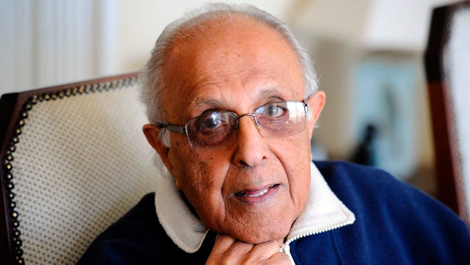 This file photo taken on July 16, 2012 shows Ahmed Kathrada, anti-apartheid activist and close friend of former South African President Nelson Mandela poses in his house in Johannesburg.