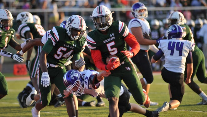 Lawrence North's Tre Bonds (5) rushed for 68 yards and a touchdown in the Wildcats' win over Brownsburg.