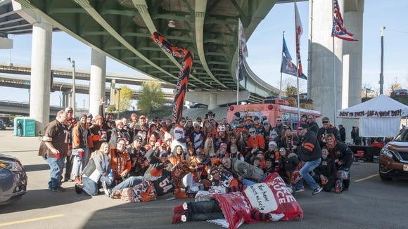 Cincinnati Bengal fans showed up for the tailgating parties in the parking lots around Paul Brown Stadium before the Bengals versus Browns football game, The Battle of Ohio. The Bengal Bomb Squad in full force.