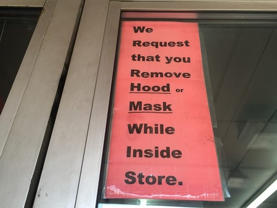A sign on a shop's door suggests security concerns