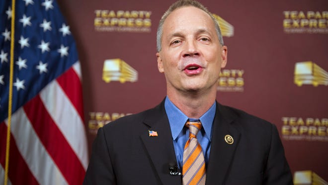 Rep. Curt Clawson, R-Fla., does a sound check as he prepares to give the Tea Party response to President Barack Obama's State of the Union address, at the National Press Club in Washington, Tuesday, Jan. 20, 2015. (AP Photo/Cliff Owen)