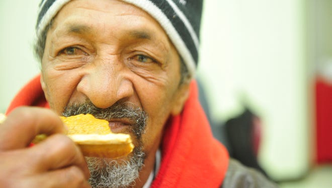 Miguel Puebla eats a piece of pumpkin pie after his meal at the Salvation Army on Thursday, Nov. 26, 2015, in Nashville.