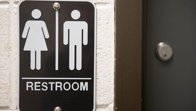 Gender neutral bathroom sign at Rutgers-Camden campus. Wednesday, December 2, 2015.