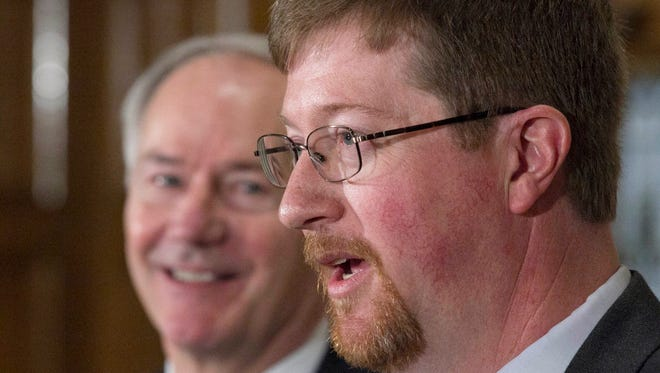 Former Mountain Home state Sen. Johnny Key, right, was appointed the state's new education commissioner this week.