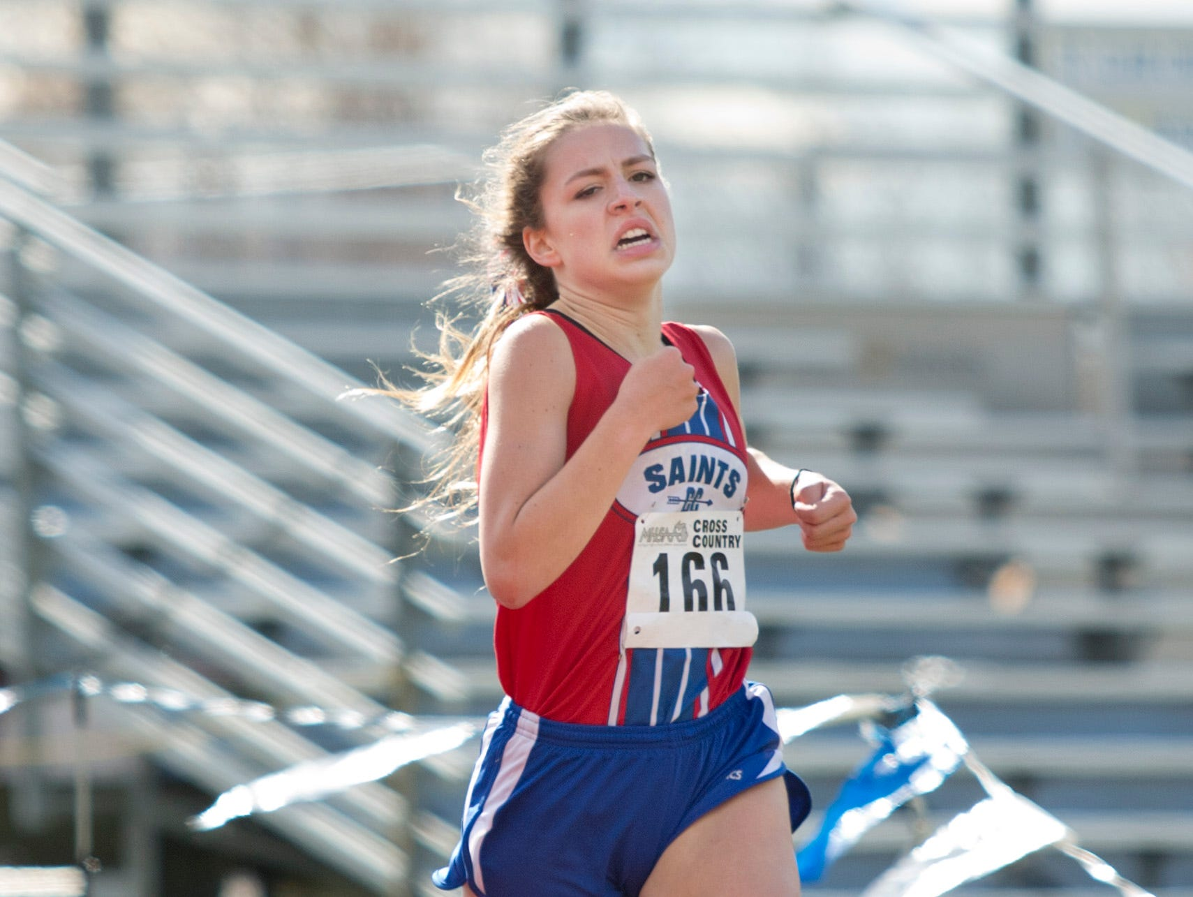 St. Clair's Gabrielle Morton runs during a regional cross county meet Friday, October 30, 2015 at Algonac High School.