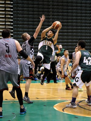 UOG Tritons AJ Carlos goes up for a shot against Outlanders Josh Wilson on May 8 at the UOG Calvo Field House.