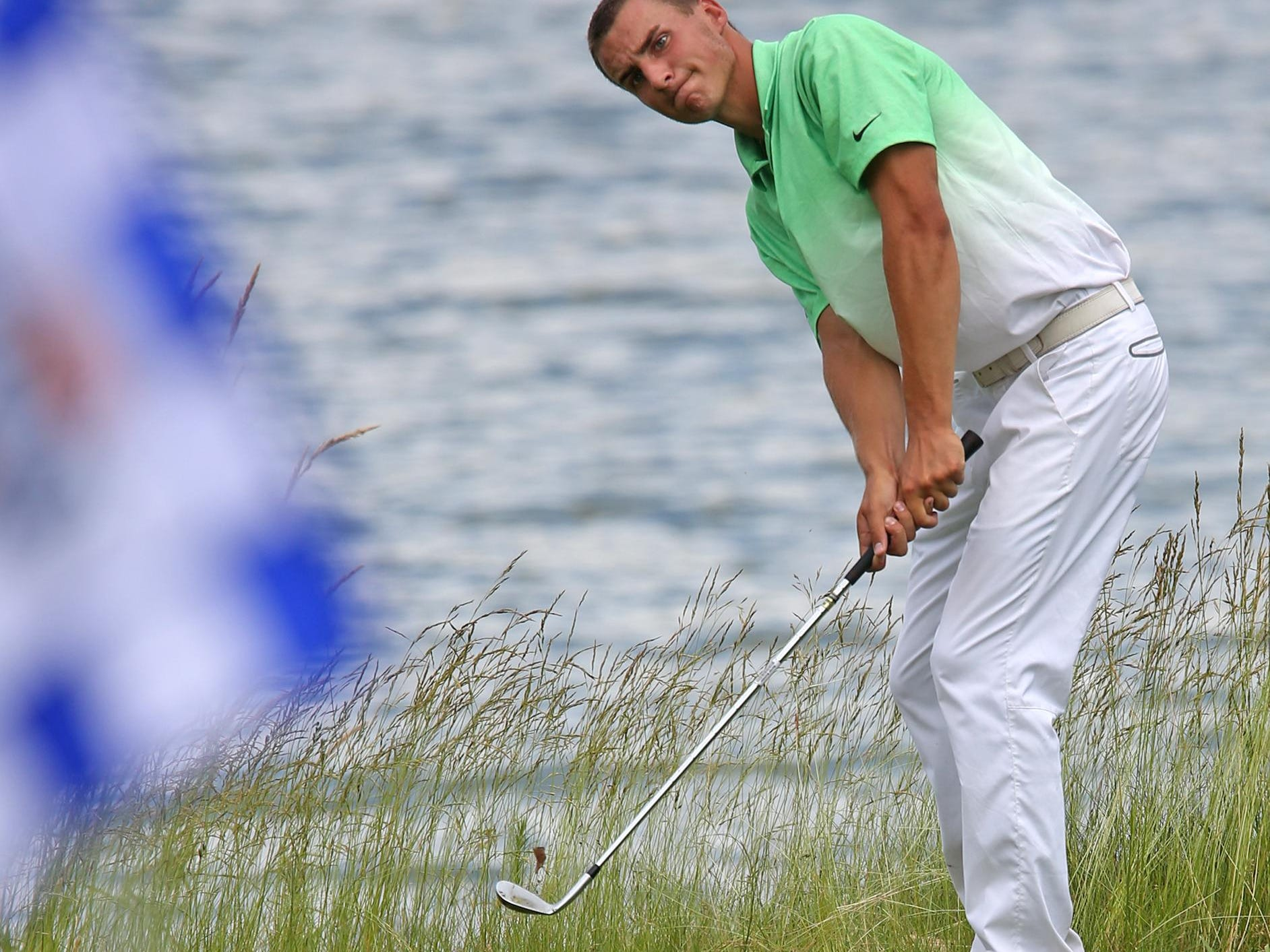 FILE -- Westfield's Timmy Hildebrand chips during the state high school golf tournament in June. He won the Indiana Open, and will attend Purdue next month.