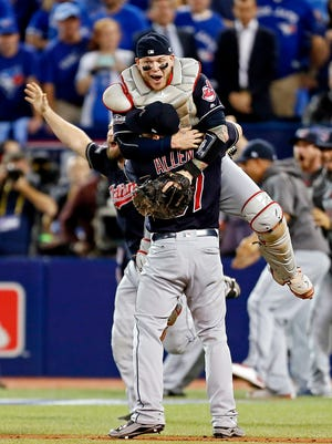 Indians catcher Roberto Perez and closer Cody Allen celebrate their Game 5 win.