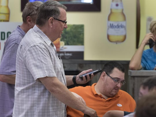 Supervisor Phil Cox waits Tuesday night for initial ballot counts in his District 3 Tulare County supervisor race with supporters at the Javi's Taco Shack in south Visalia. Initial counts showed him trailing challenger Amy Shuklian.