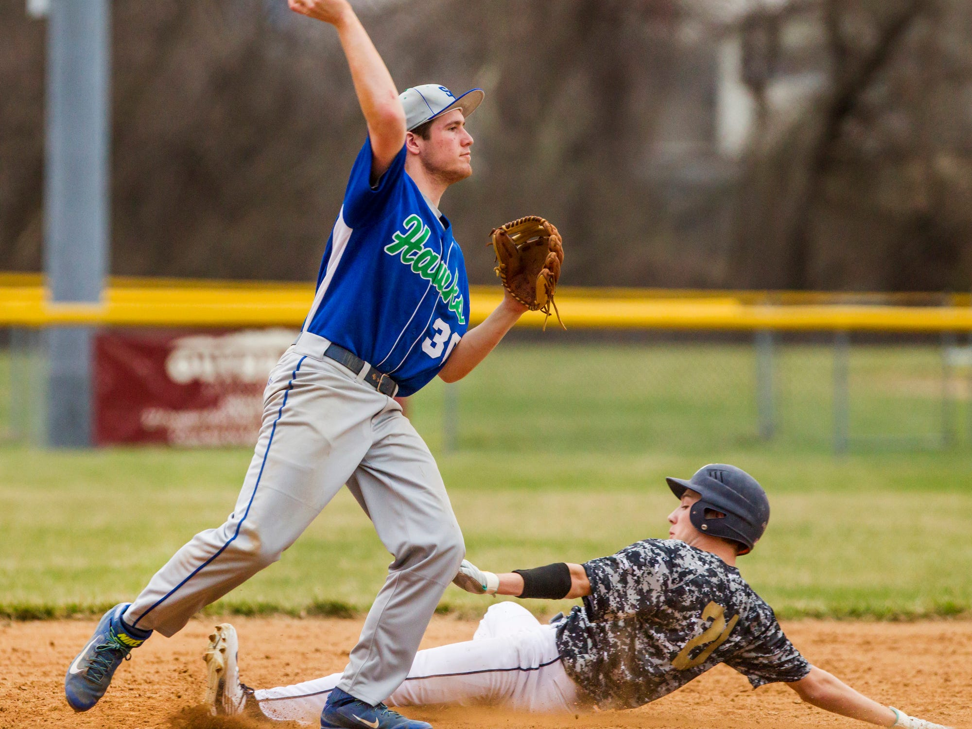 St. Georges second baseman Riley Hall turns to throw to first after putting out Delaware Military Academy's Andrew Turulski during a game at Newark National field on Tuesday afternoon.