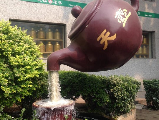 A teapot fountain outside a China tea shop spotted