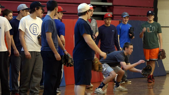 Rye players take part in drills Monday, the first day of baseball practice in Section 1.