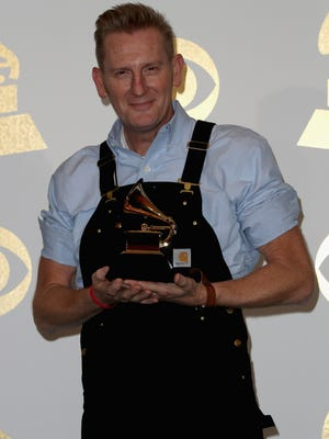 Rory Lee Feek of Joey + Rory, winner of best roots gospel album for 'Hymns That Are Important to Us,' poses in the press room during The 59th GRAMMY Awards in Los Angeles Sunday.