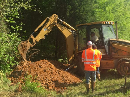 A City of Erin crew works to repair a third water line