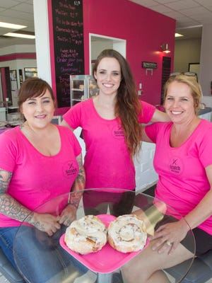 Chelsea Josefiak, center, poses with baker Ann McCarter, left, and Josefiak's mother Kristal Parkkila Wednesday, July 19, 2017 in Josefiak's recently opened Scratch Sweet Shop in Howell. Displayed on the table is a popular item at the store, cinnamon rolls.