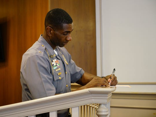Dover Chief of Police Marvin C. Mailey makes some notes before a press conference Friday at City Hall Council Chambers Friday, May 25, 2017.