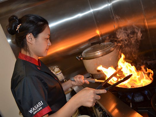 Chef Lina Lynn prepares chicken that she will use in