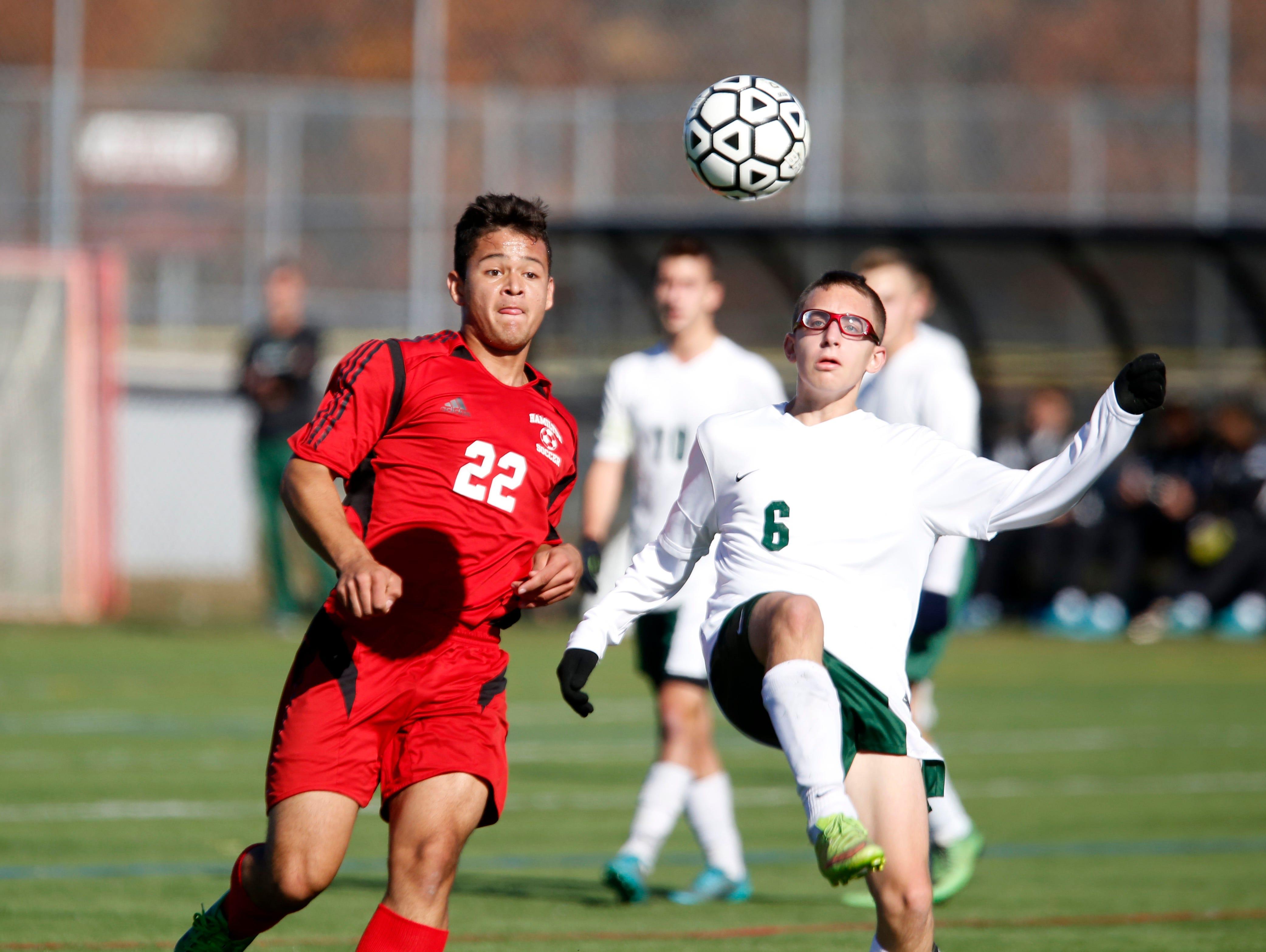 Hamilton's Virglio Cruz and Solomon Schechter's Ben Levin battle for possession in the Class C boys soccer final Oct. 30, 2015 at Arlington High School in Lagrangeville. Solomon Schechter won, 2-1, in overtime.