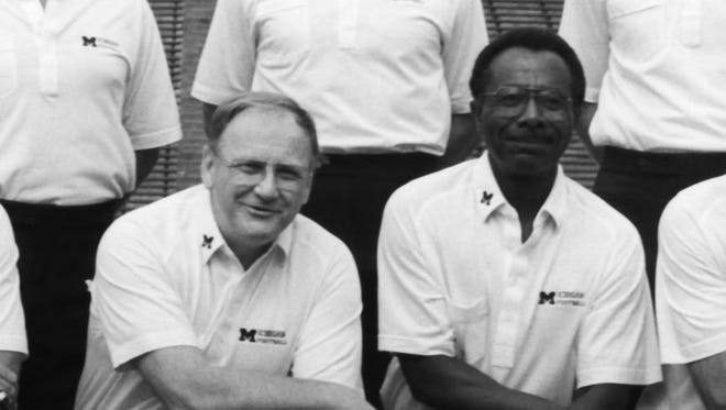 Tirrel Burton, right, joined Bo Schembechler's staff in 1970 and served until 1991.