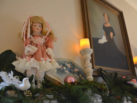 Fragrant branches of evergreens, such as cedar and cypress, as well as Victorian-themed accents, are used throughout the Kilgore Lewis House.
