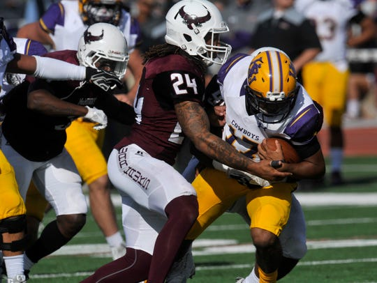 McMurry University defensive back Jordan Washington tackles Hardin-Simmons quarterback Marc Reed in the 2017 season finale. The War Hawks will open the 2018 season Thursday night against Trinity.