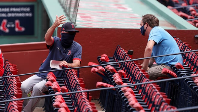 Without a crowd in seats at Fenway Park, Ron Roenicke is signaling for sound during ballgames.