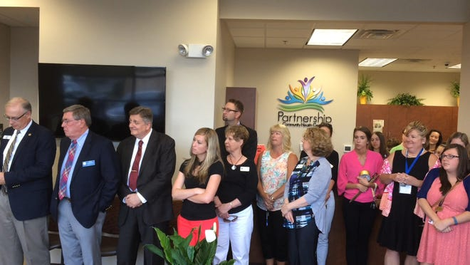 A crowd lines up for the ribbon-cutting ceremony June 18, 2015, at Partnership Community Health Care in Oshkosh.