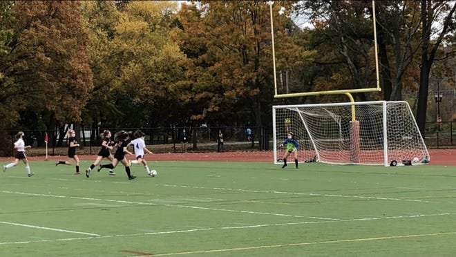 Forward Allie Caputo getting ready to take a shot that flew into the goal.