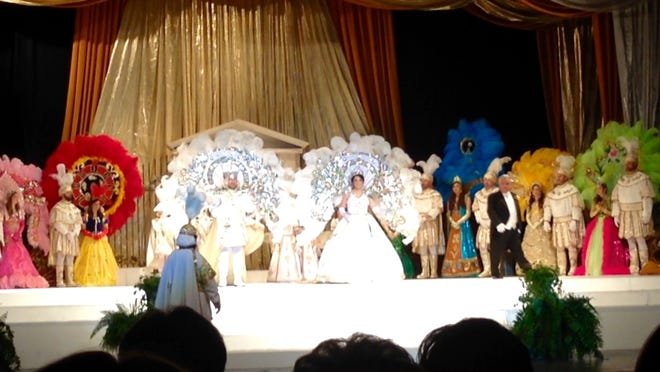 "The 2015 court of the Krewe of Houmas is presented in their elaborate costumes during the Tableau in the Houma-Terrebonne Civic Center on Monday. The king and queen wear white, while the maids don colorful costumes representing Disney princesses for this year's ""Experience the Magic"" theme."