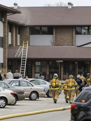 Smoke streams out of the third floor of the Parkview Haven apartments at 1325 N. Eighth St. Wednesday in Manitowoc.