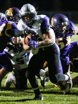 Kiel's Michael Endries (5) takes the ball into the end zone on first-and-goal for Kiel's first touchdown of the night against Two Rivers on Friday.