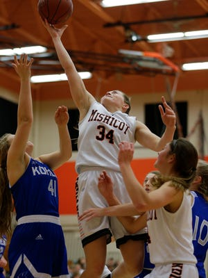 Mishicot's Karly Ayotte (34) lays it up against Kohler during a girls basketball game Thursday at Mishicot High School.